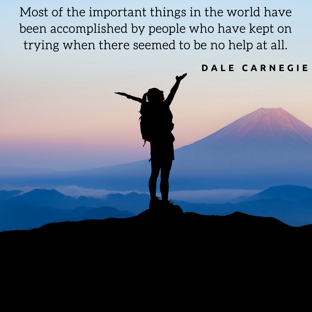 Photo of person at top of mountain with Dale Carnegie quote related to not giving up.